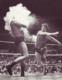 Lawler featured this image on his Christmas cards this year, showing him throwing powder in Brisco's eyes during a Memphis bout on April 24, 1977.